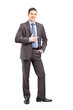 Full length portrait of a young businessman standing and pointin