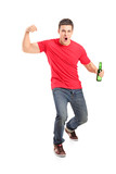 Full length portrait an euphoric fan holding a beer bottle and c