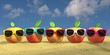 five apples with colourful sunglasses at the beach