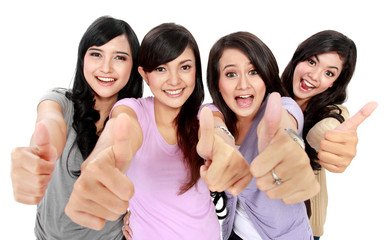 Group of beautiful women showing thumbs up
