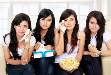 group of teenager watching sad Movie