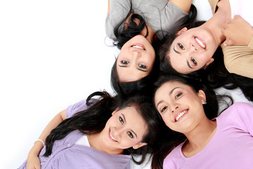 teenage girls lying on white floor