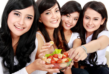woman friend having salad together