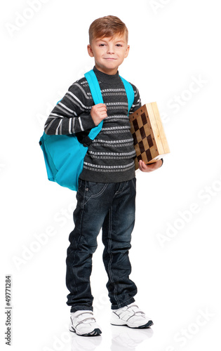 Boy with backpack and chessboard