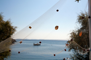 Hanged fishing net and sea in the background