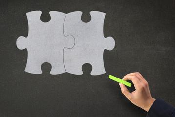 Puzzleteile beschriften auf Kreidetafel