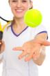Closeup on ball throwing up in air by tennis player