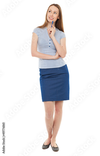 Young businesswoman looking up
