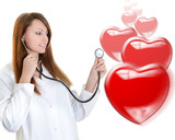Cheerful female doctor listening heartbeat