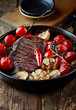 Grilled beef steak with rustic vegetables in a ceramic dish