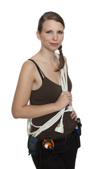 Young craftswoman with a tool belt in front of white background