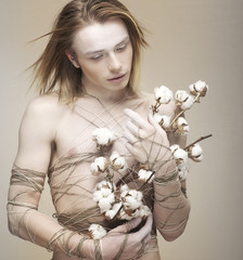 Bloke. Daydreaming Young Man holding Bouquet of Flowers. Cotton