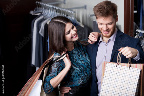 Attractive woman and young man go shopping
