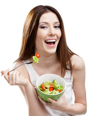 Dieting woman eats green salad in salad bowl, isolated on white