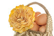 natural basket with eggs and flowers
