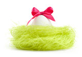 Egg with pink bow is in the nest of sisal filler poster