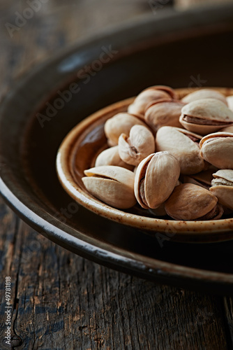 Pistachios on a dark ceramic plate