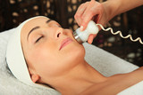 Young woman receiving massage  - microdermabrasion poster