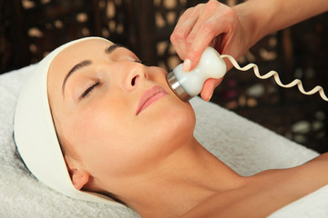 Young woman receiving massage  - microdermabrasion