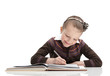 Pupil writes something at her copybook, isolated