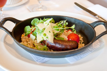Grilled lamb merguez sausage with fregola, cress and  parmigiano