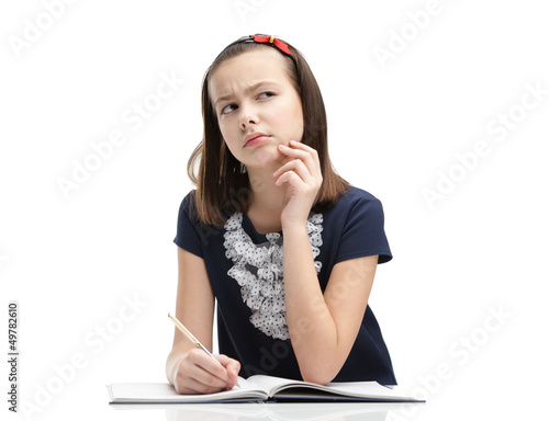 Schoolgirl thinks over the task, isolated
