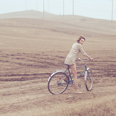 beautiful young woman on a bicycle