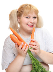 Overweight woman with fresh carrot. Diet concept.