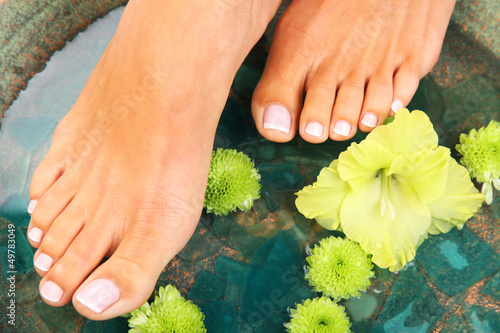 Beauty treatment photo of nice pedicured feet - 49783049