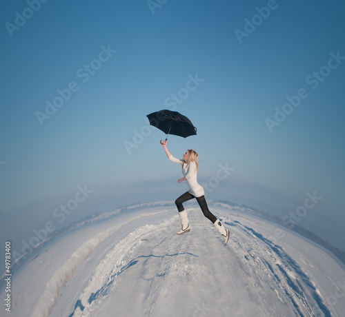 beautiful girl with an umbrella flies over the land round