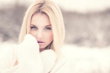 beautiful blonde freezing outdoors in winter