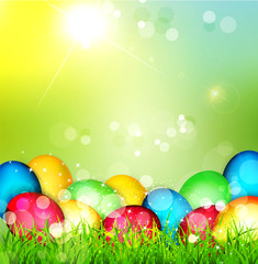 Vector painted Easter eggs lying in the grass against the sky an