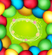 vector background with frame of Easter eggs on a green backgroun