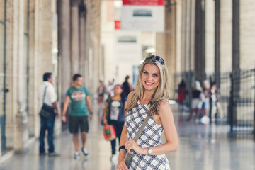 Beautiful Young Woman Is Posing  at the Railway Terminal