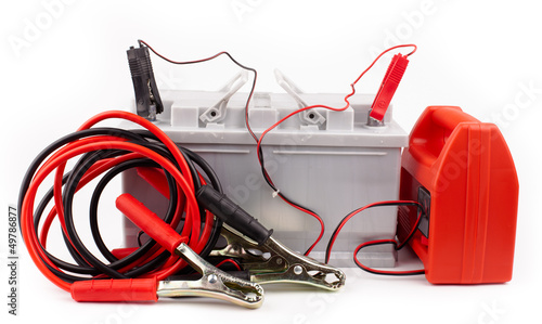 Car battery and  jumper cables  isolated on white