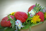 Fresh strawberries and flower