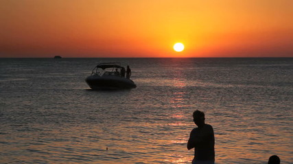 Posing Guy in the shadows in front of the balearic sunset