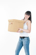 attractive young woman is carrying the box