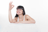 """woman is showing """"ok"""" sign"""