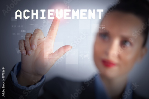 Business woman touching display