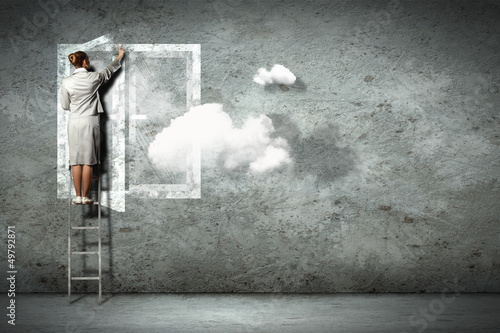 Business woman on ladder