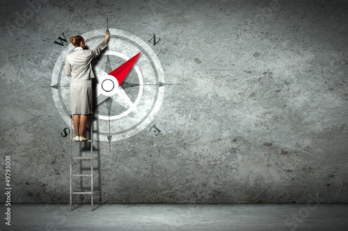 Business woman drawing compass