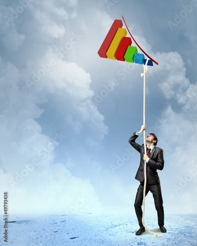 Image of businessman climbing rope