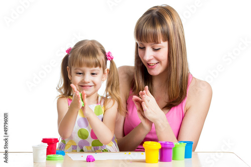 mother teeaching daughter to use colorful play dough