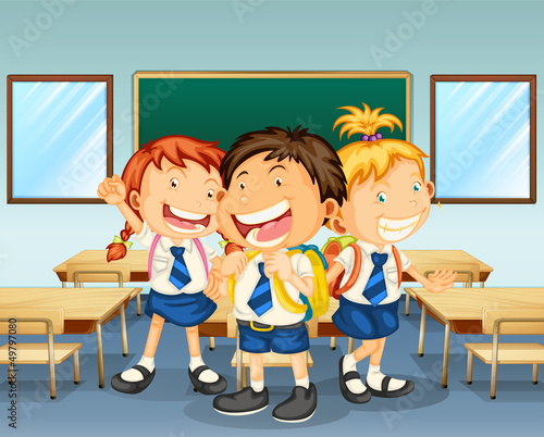 Three children smiling inside the classroom