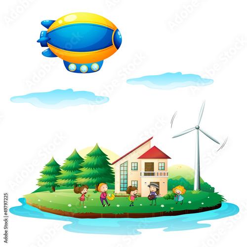 Foto op Canvas Boerderij Children near the windmill
