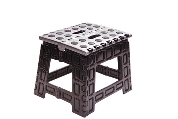 plastic folding stool on a white background