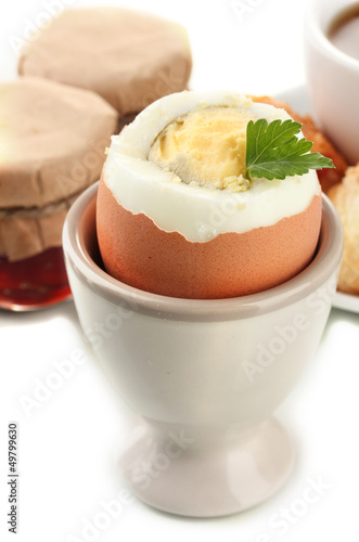 Light breakfast with boiled egg and coffee, isolated on white