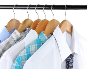 Shirts with ties on wooden hanger isolated on white