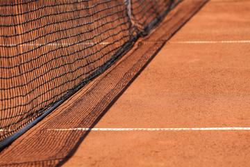 Tennis net & red ground